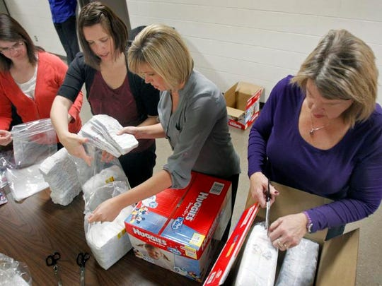 Thrivent Financial for Lutherans employees, from left, Amy Weyenberg, Teresa Floeter, Stacy Vander Linden and Lynn Eckes package boxes of diapers as part of the United Way Fox Cities Diaper Bank on Nov. 20. The Diaper Bank was cited as a particular success last year.