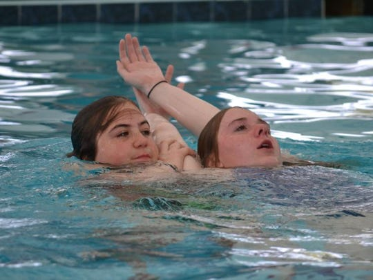 Valerie Cannuli, left, practices rescuing Katie Bear during a lifeguarding class at the Sports Core pool in Ocean Pines. Both girls were students in a class offered by Ocean Pines Association instructors.