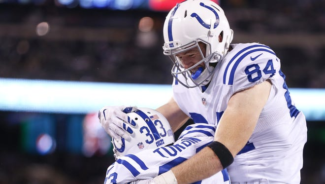 Indianapolis Colts running back Robert Turbin (33) celebrates with tight end Jack Doyle (84) after a 5 yard touchdown carry against the New York Jets during the fourth quarter at MetLife Stadium in East Rutherford, N.J., on Monday, Dec. 5, 2016.