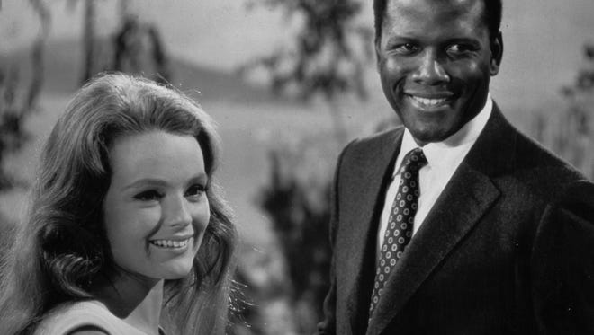 """Sidney Poitier and Katharine Houghton starred as an interracial couple in 1967's """"Guess Who's Coming to Dinner."""""""