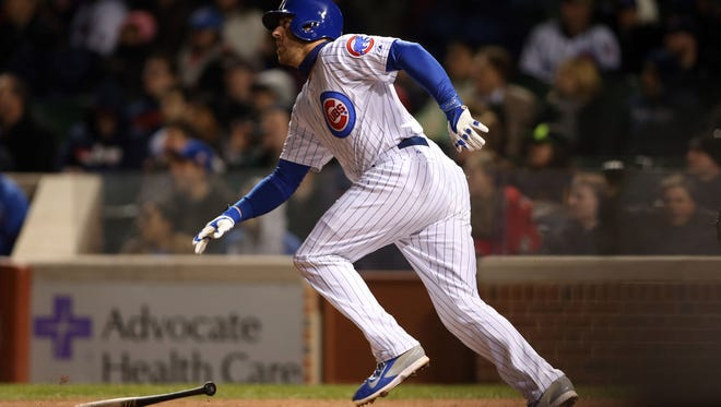 Chicago Cubs third baseman Mike Olt hits a three-run home run against the Arizona Diamondbacks during the fifth inning at Wrigley Field on April 22, 2014.