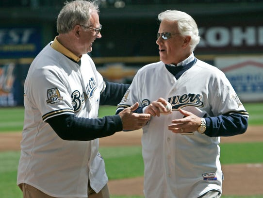 Jerry McNertney hands the ball to former pitcher Lew