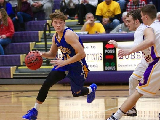 Waynesboro's Cameron Keck dribbles down court against Boiling Springs on Friday night. The Indians won, 60-46.