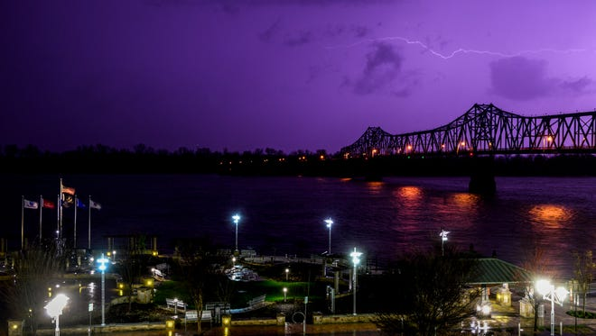 Lightning spreads over Smothers Park and Glover Cary Bridge in Owensboro, Ky., Tuesday evening, April 3, 2018.