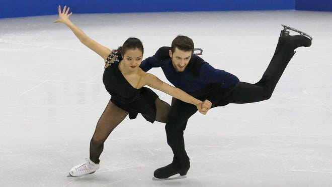 Yura Min and Alexander Gamelin from South Korea perform in the Ice Dance Short Dance program at the ISU Four Continents Figure Skating Championships in Gangneung, South Korea, Feb. 16, 2017.