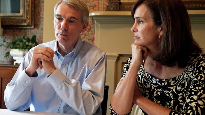 Sen. Rob Portman, R-Ohio, is interviewed along with his wife Jane on Monday in Lebanon. Portman says he will wait until after the midterm elections to decide whether to mount a presidential run or to focus on winning a second Senate term in 2016.