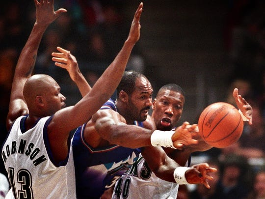 Despite surrounding Utah's Karl Malone on this play, the Bucks defense allowed him to score 40 points in a 1999 game.
