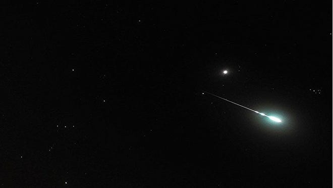 An unusually bright Geminid meteor on Dec. 12, 2012. Constellation Orion is on the left and the Pleiades star cluster at far right; Jupiter was in this part of the sky at the time and appears like a bright star above the meteor. [Photo by John Flannery (Own work) [CC BY-SA 2 (https://creativecommons.org/licenses/by-sa/2)], via Wikimedia Commons]