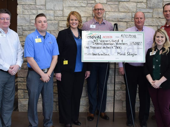 Festival Foods and Acosta present a check for $5,000