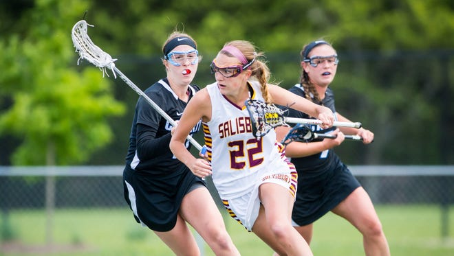 Salisbury attack Megan Wallenhorst (22) works behind the crease against Cabrini in the NCAA D3 Women's Lacrosse tournament second round at Sea Gull Stadium in Salisbury on Sunday, May 15.