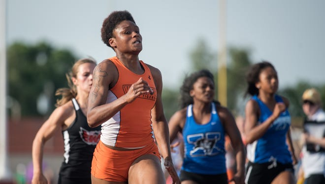 Withrow's Doneasha Brewer wins the girl's 100 meter dash.