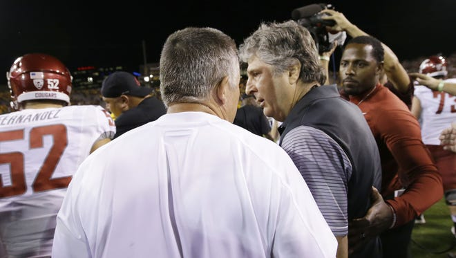 Arizona State head coach Todd Graham speaks to Washington State head coach Mike Leach during their postgame greeting during PAC-12 action on Saturday, Oct. 22, 2016 in Tempe, Ariz.