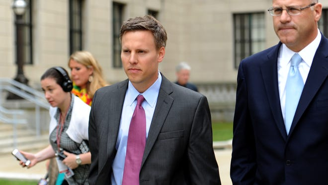 Bill Stepien, left, former campaign manager for Governor Chris Christie and his attorney Kevin Marino, leave the State House on Monday, June 9, 2014.
