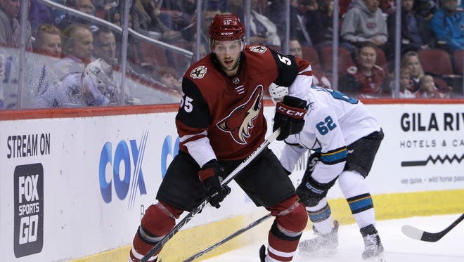 Arizona Coyotes defenseman Jason Demers skates away from San Jose Sharks right wing Kevin Labanc (62) in the first period during an NHL hockey game, Tuesday, Jan. 16, 2018, in Glendale, Ariz.