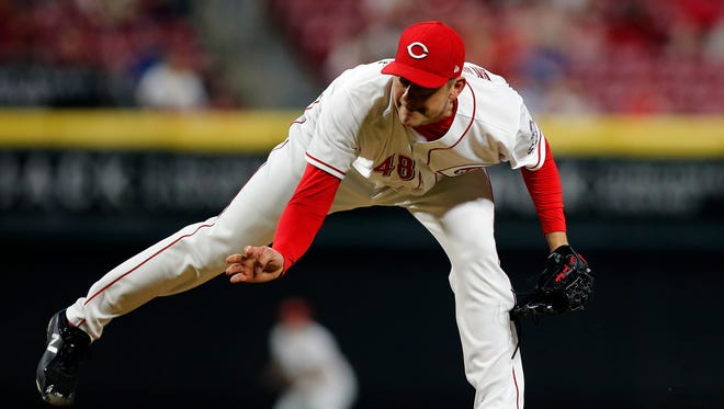 Cincinnati Reds relief pitcher Jared Hughes (48) follows through on a pitch in the top of the eighth inning of the MLB National League game between the Cincinnati Reds and the Miami Marlins at Great American Ball Park in downtown Cincinnati on Friday, May 4, 2018. Raisel Iglesias tallies a save as the Reds win 4-1.