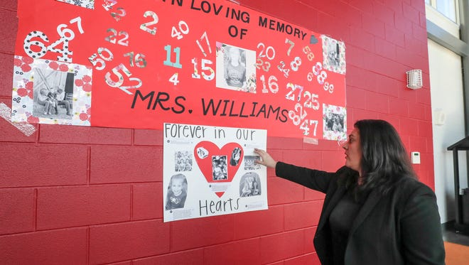 PRP High School principal Kim Salyer talks about the banners made in remembrance of Amanda Williams.  Williams, a teacher at the school and wife of the school's football coach, died during the delivery of twins.  The football team and cheerleaders made the banners that hang inside the school.  Williams coached the cheerleaders.