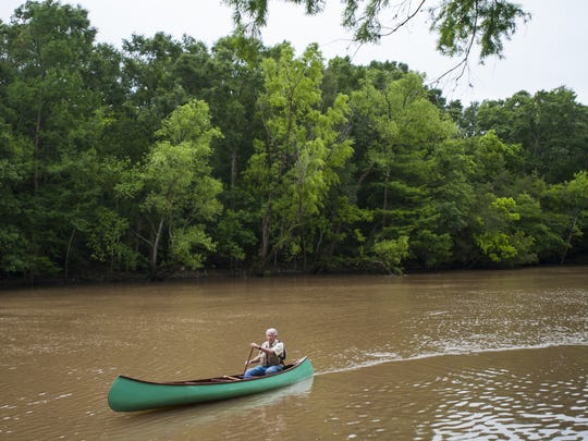 Harold Schoeffler pilots a canoe along the Vermilion River in Lafayette, LA, Wednesday, May 14, 2014. Schoeffler's father purchased the canoe for him in 1949, and Schoeffler recently had the vessel restored.   Paul Kieu, The Advertiser