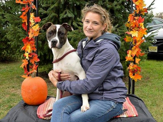 Jen Furman, pictured here with Max, one of the adoptable dogs at the Burlington County Animal Shelter.