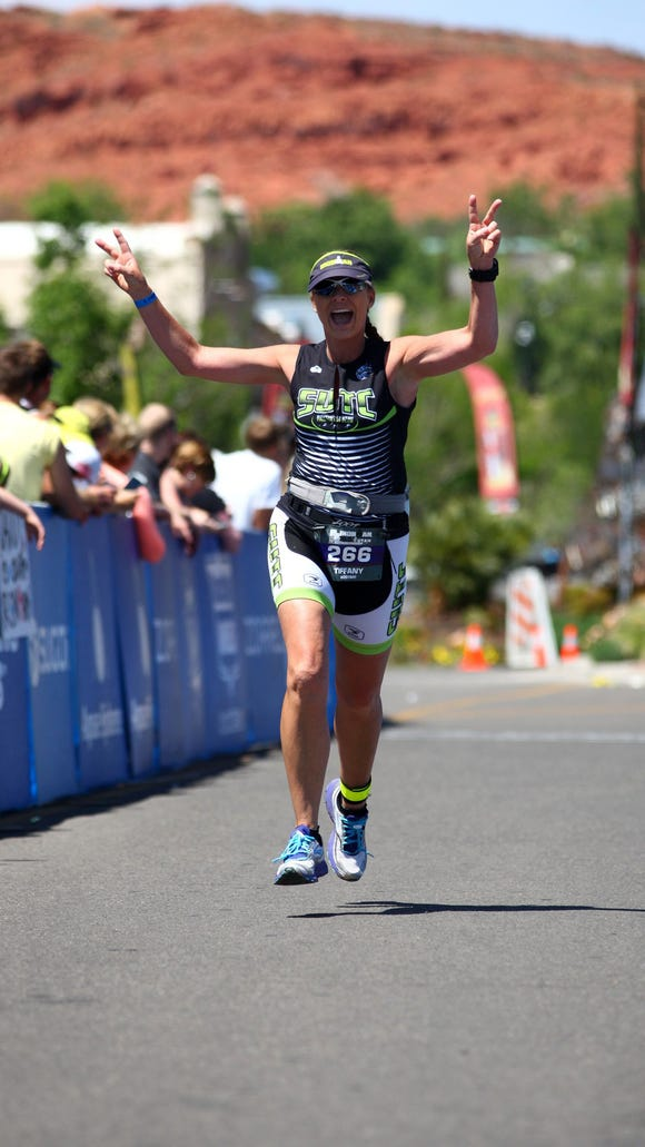 Tiffany Gust closes in on the finish line during the 2014 Ironman St. George 70.3.