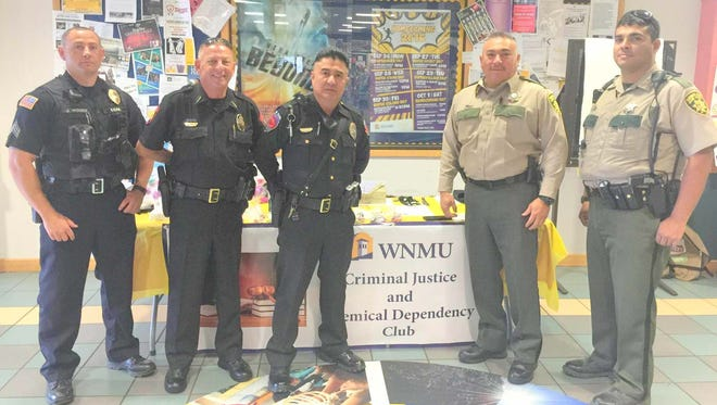 Area law enforcement helped the WNMU Criminal Justice and Chemical Dependency Club with its Arrest a Professor Fundraiser that was held Thursday. From left, are Silver City police officer Jason Woods, Bayard police chief Willie Kerin, Santa Clara police officer Jaime Serrano, Grant County Sheriff's deputy Sam Rodriguez and Grant County Sheriff's deputy Jacob Vega.