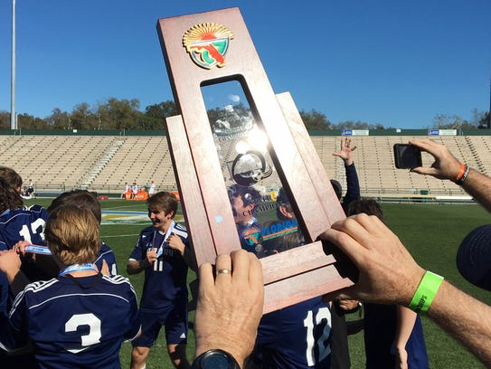 Maclay players celebrate their Class 1A state title
