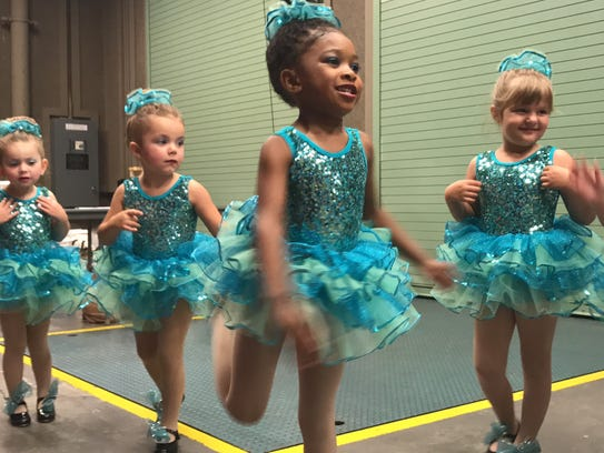 Young girls practice backstage at the Saenger Theatre