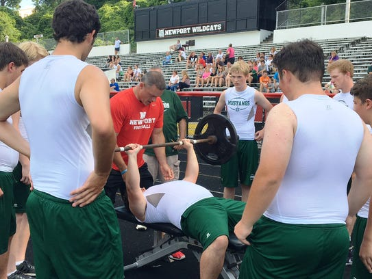 Brossart linemen cheer on a teammate during a bench
