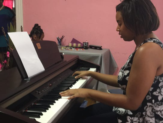ASU senior, Corelia Davis plays the piano at Diana
