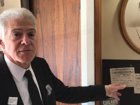 Dr. Frank J. Mazzarella, chief medical officer at Clara Maass Medical Center in Belleville on Monday, Feb. 5, points to a letter which nurse Clara Maass wrote while on her deathbed. Clara Maass will be inducted into the New Jersey Hall of Fame.