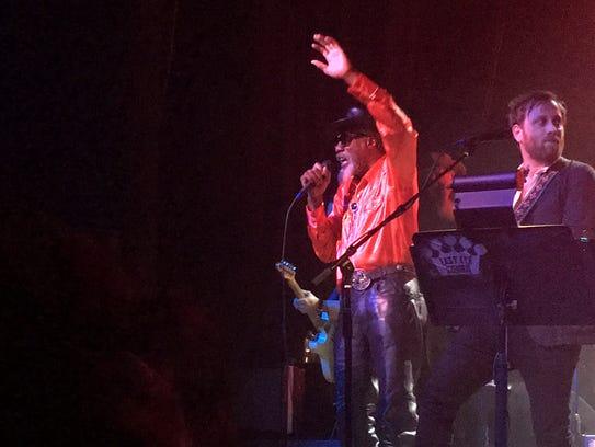 Louisiana musician Robert Finley (left) performs with