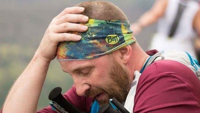 Shippensburg's Mark Grove takes a moment to recover after reaching Hyner View during last weekend's Hyner 25K.