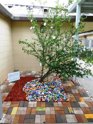 Woodville's rock garden contains 600 rocks painted by students, faculty, and staff