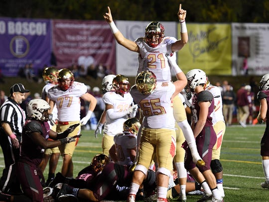 Bergen Catholic's Johnny Langan (21) celebrates after scoring a touchdown in the second quarter against Don Bosco at Granatell Stadium during the NJSFC United Red rivalry game on Friday, Oct. 27, 2017.