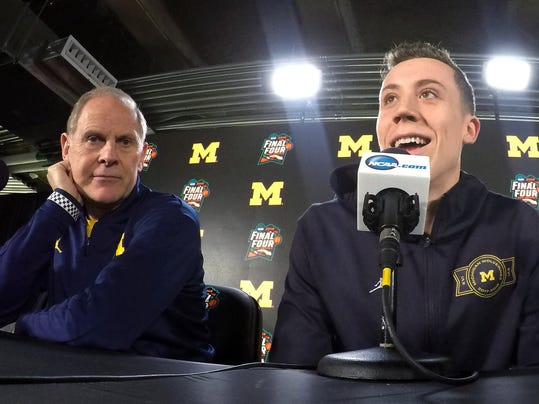 Michigan's Duncan Robinson, right answers questions as head coach John Beilein listens during a news conference for the championship game of the Final Four NCAA college basketball tournament, Sunday, April 1, 2018, in San Antonio. (AP Photo/Tim Donnelly)