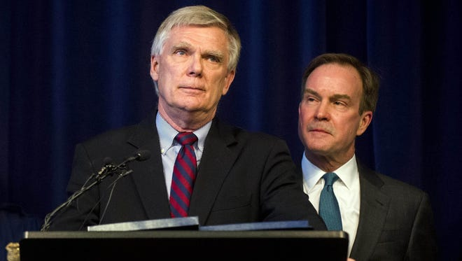 William Forsyth, a former Kent County prosecutor, speaks after Attorney General Bill Schuette, right, announced an open and ongoing investigation into the systemic issues with sexual misconduct at Michigan State University that began in 2017 on Saturday, Jan. 27, 2018 at the G. Mennen Williams Building in Lansing.  (Jake May/The Flint Journal-MLive.com via AP)