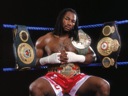 24 Jul 2000:  World Heavyweight Champion Lennox Lewis of Great Britain shows off his IBO, WBC and WBA title belts during a feature shoot in London.