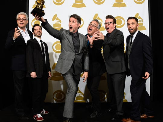 LOS ANGELES, CA - FEBRUARY 08:  Musician Gordon Goodwin (C) and Gordon Goodwin's Big Phat Band, winners of Best Large Jazz Ensemble Album for 'Life in the Bubble,' pose in the press room during The 57th Annual GRAMMY Awards at the STAPLES Center on February 8, 2015 in Los Angeles, California.  (Photo by Frazer Harrison/Getty Images)