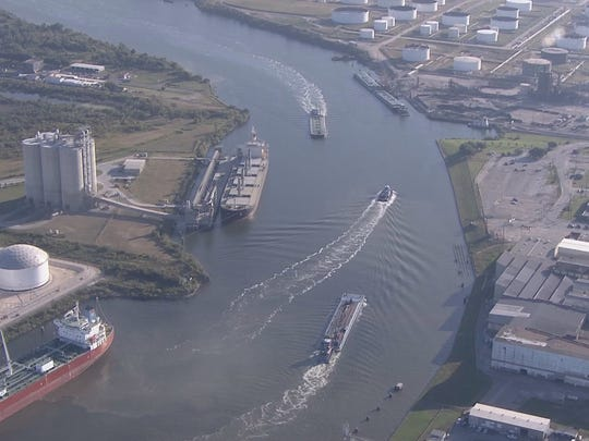 Two vessels are partially submerged after an incident in the Houston Ship Channel just south of Galena Park.
