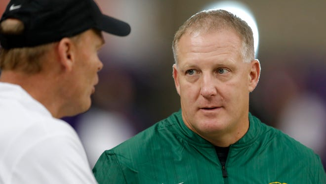 FILE - In this Oct. 6, 2018, file photo, North Dakota State head coach Chris Klieman, right, talks with Northern Iowa head coach Mark Farley, left, before an NCAA college football game in Cedar Falls, Iowa. Kansas State hired Klieman to lead its football program Monday, Dec. 10, 2018, passing the reins from retired Hall of Fame coach Bill Snyder to someone with three Football Championship Subdivision titles but little Big 12 experience. (AP Photo/Charlie Neibergall, File)