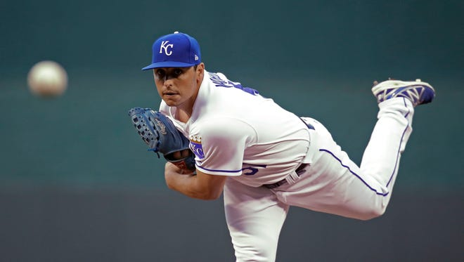 Kansas City Royals starting pitcher Jason Vargas throws during the first inning of a baseball game against the Oakland Athletics Thursday, April 13, 2017, in Kansas City, Mo. (AP Photo/Charlie Riedel)