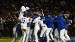Cubs celebrate after the 6-4 victory.