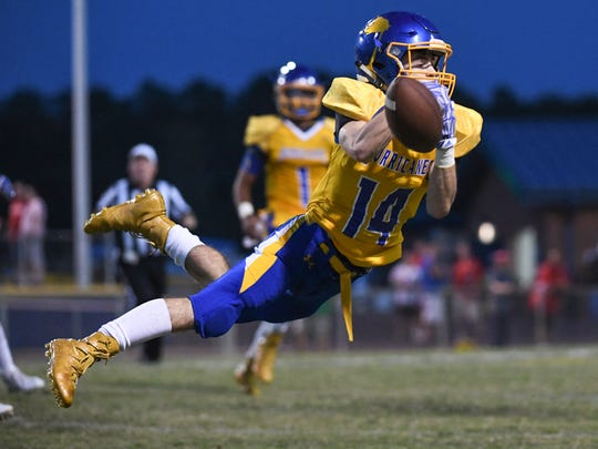 Wren junior Luke Bryant dives for a pass playing Palmetto during the first quarter at Wren High School in Piedmont on Friday.