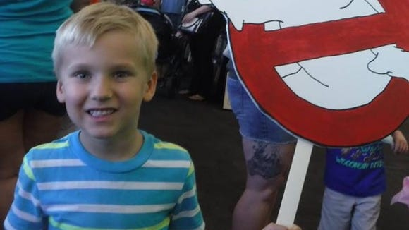 Thomas Yates, 5, of Tempe, enlisted the help of a Ghostbuster.