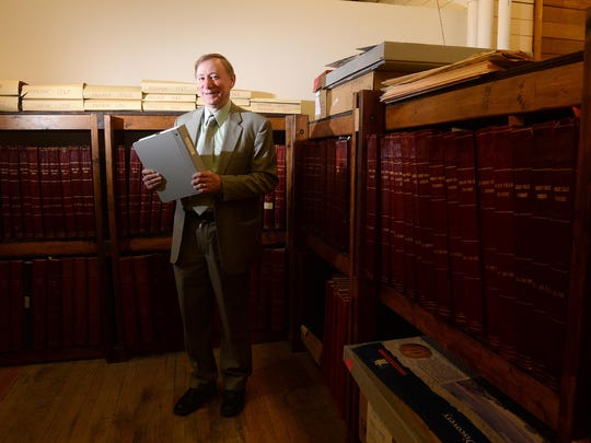 Jim Meinert, executive director of The History Museum, stands in the museum's archive room as the museum prepared to celebrate its 40th anniversary in 2016.