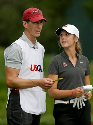 Rachel Heck talks with her father and caddie, Robert Heck, before teeing off on the 14th hole during the first round of the U.S. Women's Open Golf tournament Thursday, July 13, 2017, in Bedminster, N.J.