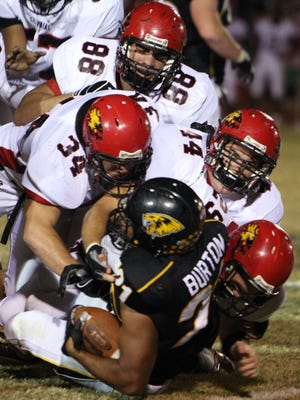 Chaparral defenders bring down Saguaro's Beau Burton during a rivalry game in 2008 at Saguaro High School.