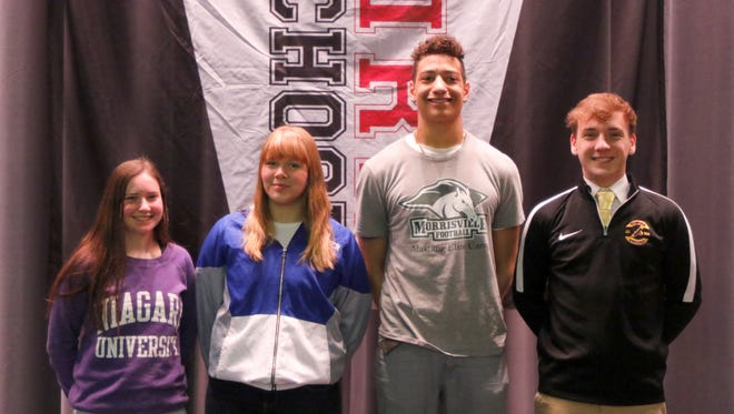 Elmira High School athletes, from left, Casey Roman, Lyndsey Cobb-Wilkins, Josh Stroman and Gavin Wise during a signing ceremony at the school on April 12.