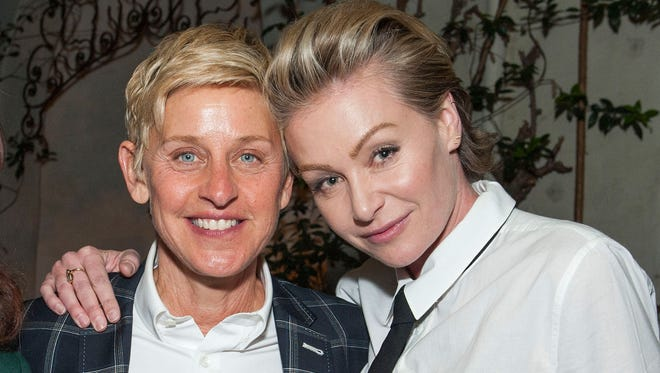 "Ellen DeGeneres (L) and Portia de Rossi attend Arianna Huffington's ""Thrive""  book party hosted by Victoria Jackson, Kathy Freston And Dean Ornish on May 8, 2014 in Beverly Hills, California."