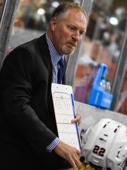 St. Cloud State women's hockey coach Eric Rud diagrams