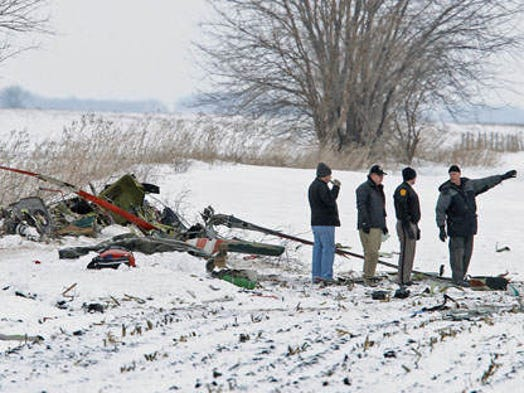 A FAA investigator and law enforcement officials were on the crash scene of a medical helicopter that went down about one mile north of Ventura, Iowa Jan. 2, 2013. The helicopter was with Mercy Medical Center - North Iowa, of Mason City. This view is looking north.